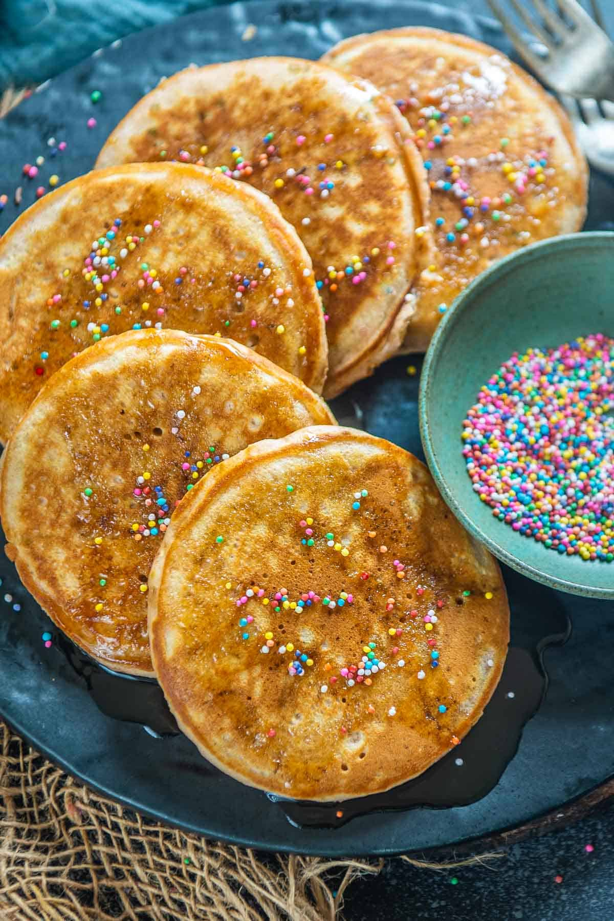 Funfetti pancakes served on a plate.