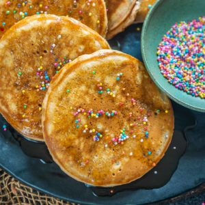 These super soft and fluffy funfetti pancakes come together from scratch in just 15 minutes using simple ingredients. Serve these for breakfast or dessert.