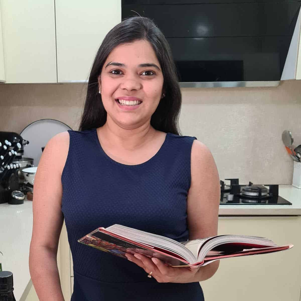 Neha Mathur with a book in hand