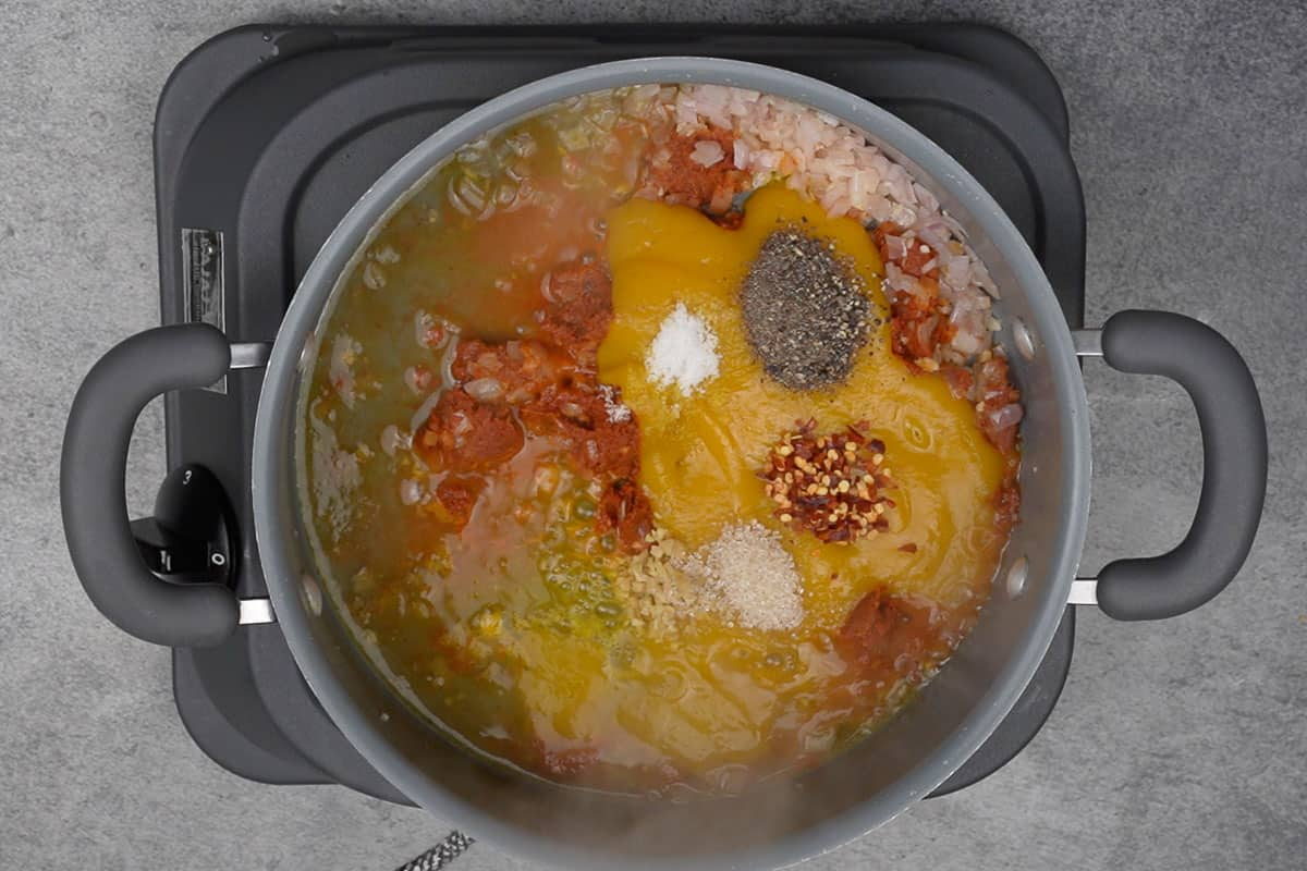 Pumpkin puree, some vegetable broth, ginger, brown sugar, red pepper flakes, salt and pepper added to the pan.