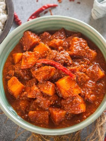 Aloo vindaloo is a vegetarian version of the popular Goan vindaloo curry. Serve it with steamed rice or paratha for a delicious meal. Here is how to make it.