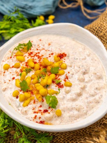 Boondi Raita is a healthy and delicious Indian accompaniment made with yogurt and boondi (small fried balls made of chickpea flour). This raita comes together in under 5 minutes and pairs very well with Indian meals. Here is how to make it.