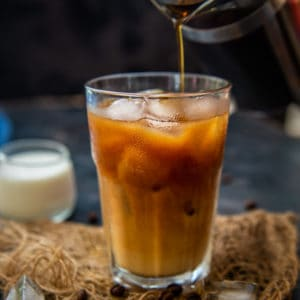 Make this DIY French Press Cold Brew at home. It's smooth, less acidic, and much cheaper than the store-bought stuff. All you need is a French Press, cold water, and ground coffee.
