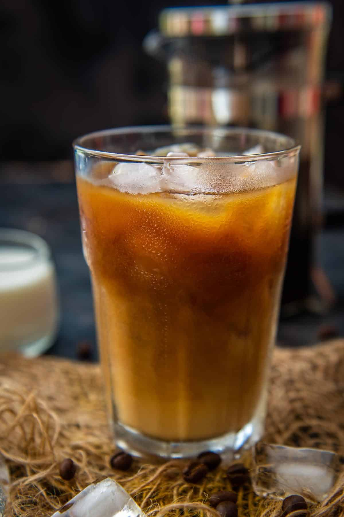 Close up shot of french press cold brew in a glass.
