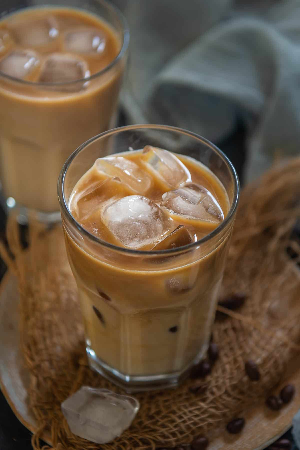 Iced vanilla latte served in a glass.