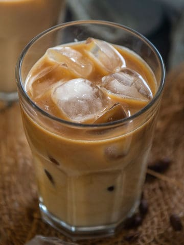 Creamy and yummy, this Starbucks copycat iced vanilla latte is perfect to sip on warm summer days. It is very easy to make and gets ready in under 5 minutes using 3 simple ingredients.