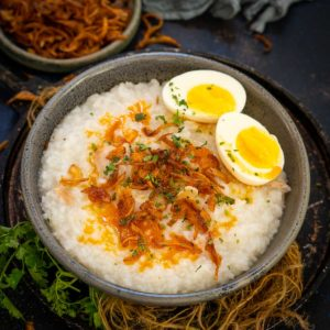 Make this warm and comforting instant pot congee using just 5 ingredients and 5 minutes of active working time. No stirring and no mess to make this one-pot savory rice porridge.