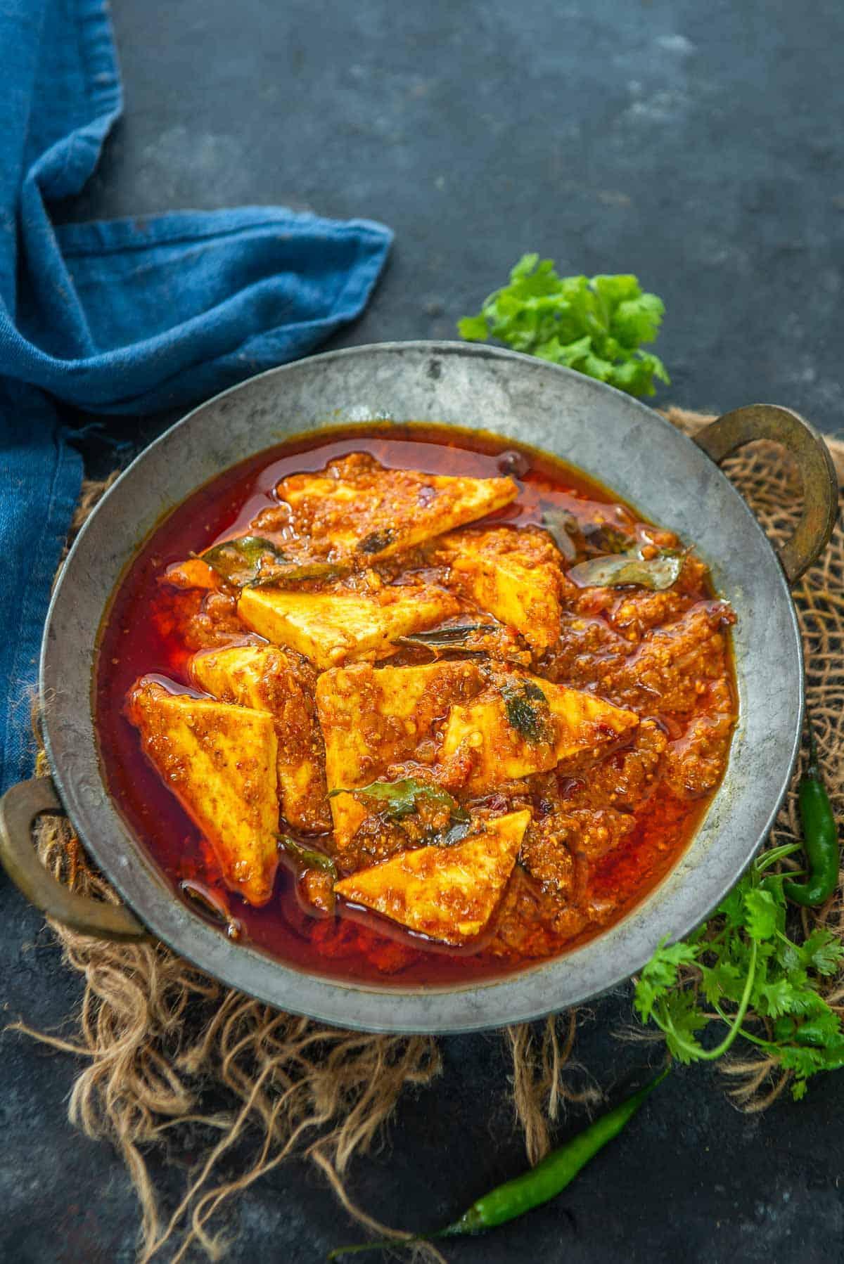 Paneer ghee roast served in a bowl.