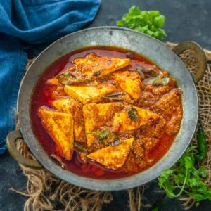 Paneer Ghee Roast is a fiery red and spicy curry that is a vegetarian version of Mangalorean chicken ghee roast. This dryish curry is best served with neer dosa, dosa, or lachha paratha.