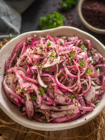 This 5 minutes Sumac Onion is a Turkish-style onion salad that adds a nice crunch to anything it's added to.