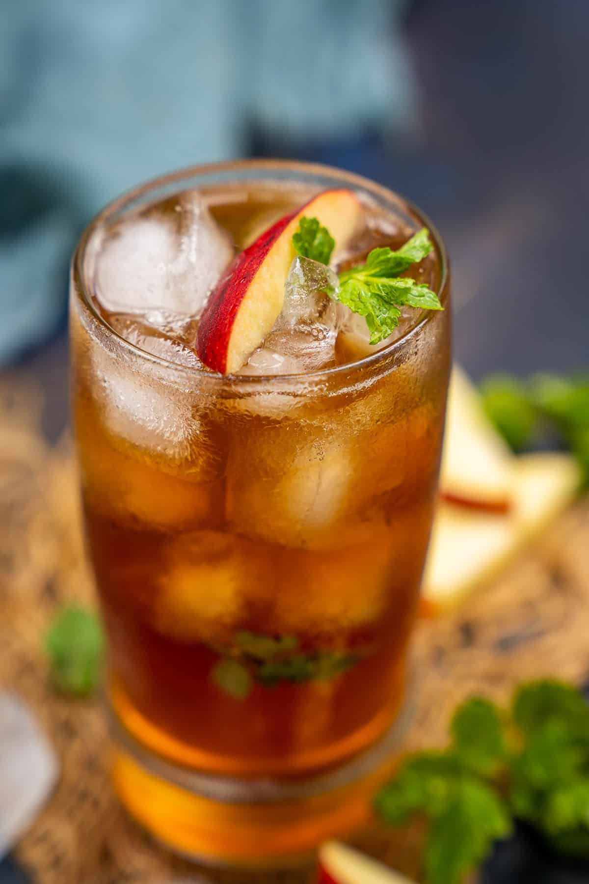 Apple iced tea served in a glass.