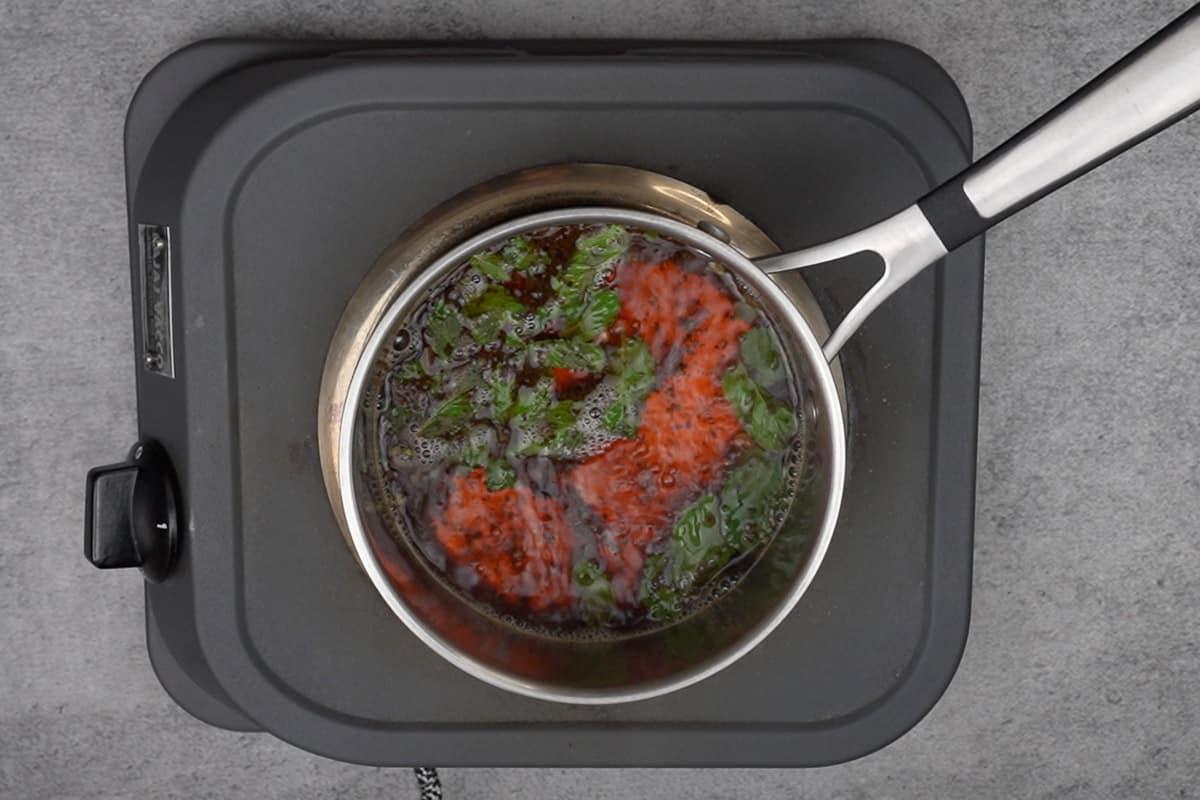 Tea simmering in a pan.