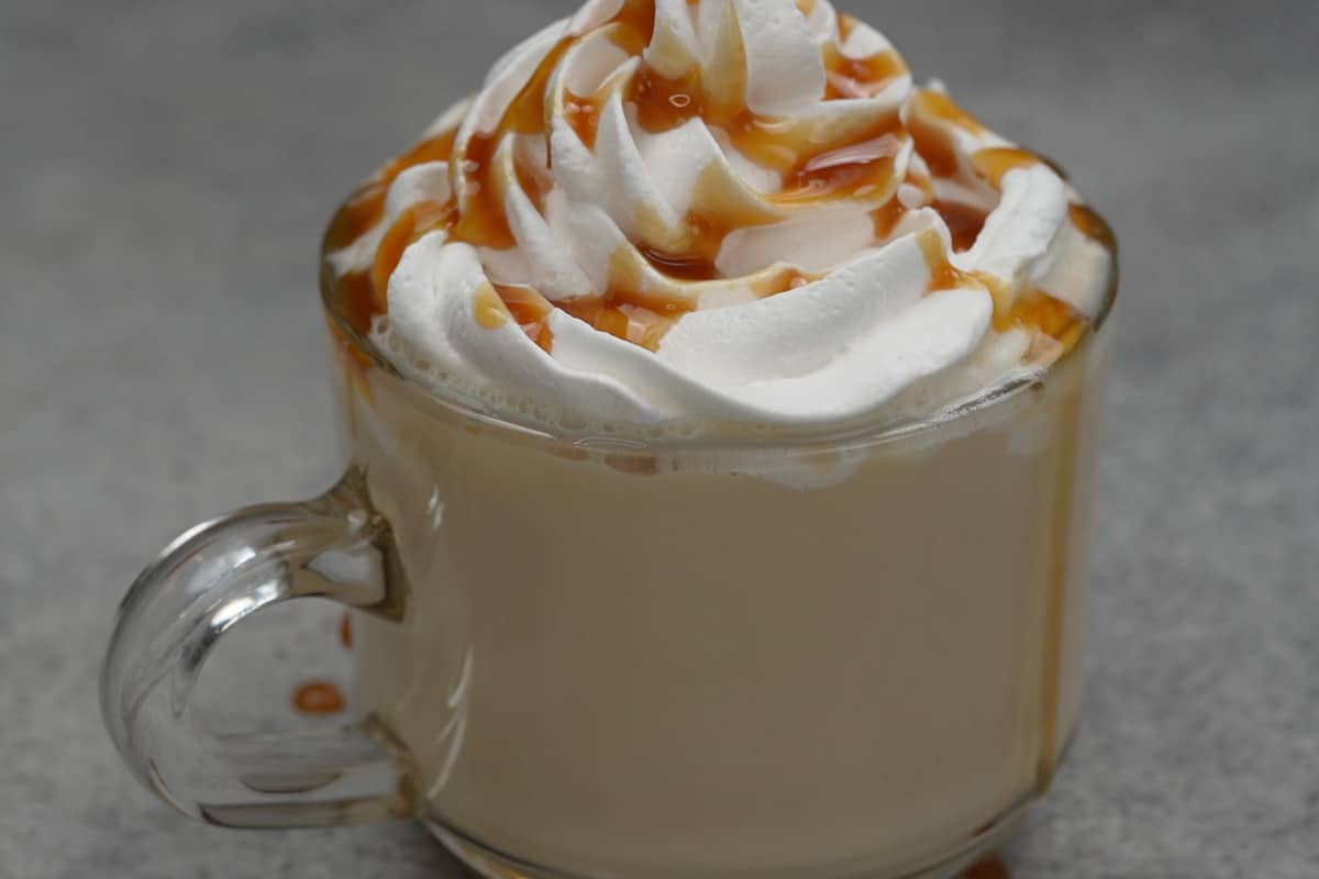 Ready caramel latte topped with whipped cream and caramel syrup.