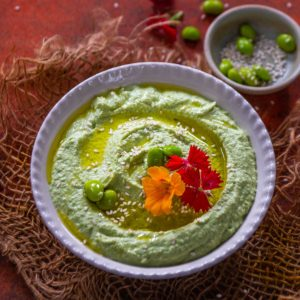 Rich, creamy, and high in protein, this easy Edamame Hummus gets done in 15 minutes. Serve it with veggies, crackers, or pita bread for a healthy appetizer. It's vegan and gluten-free too.