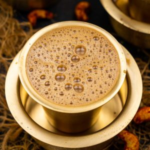 South Indian filter coffee is a traditional Indian style coffee that is made using a special filter. A coffee decoction is brewed which is mixed with hot milk and sugar to create a perfect cuppa. Learn to make filter coffee in true South Indian style and serve it in a tumbler in style.