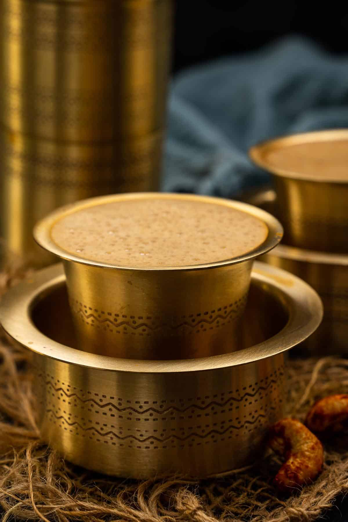 South Indian filter coffee served in a traditional tumbler.