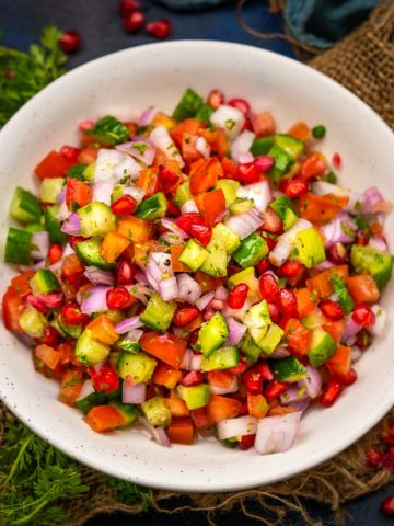 Made using freshly chopped veggies, Kachumber is a fresh, crunchy Indian salad that doesn't need any cooking and can be rustled up whenever hunger strikes. Pair it with any Indian meal for a taste lift. It is vegan, gluten-free, and oil-free.