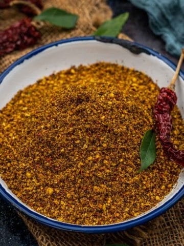 Karivepaku Podi or curry leaf powder brings together a refreshing flavor of curry leaves, and spices and it is ideal to be served with a bowl of rice or with idlis. Here is how to make it.