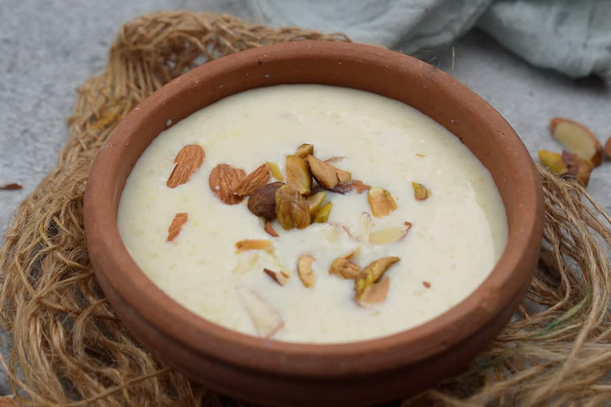 Ready phirni served in a clay bowl.