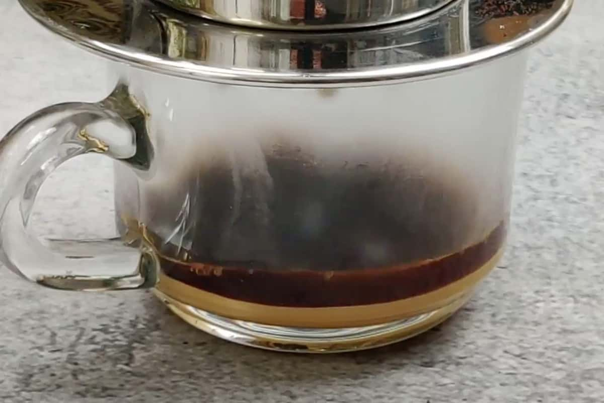 Coffee dripping in the cup.