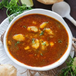 Aloo ki launji is a Punjabi-style sweet and spicy potato curry. It pairs very well with poori and paratha and can be made in under 20 minutes using simple ingredients.
