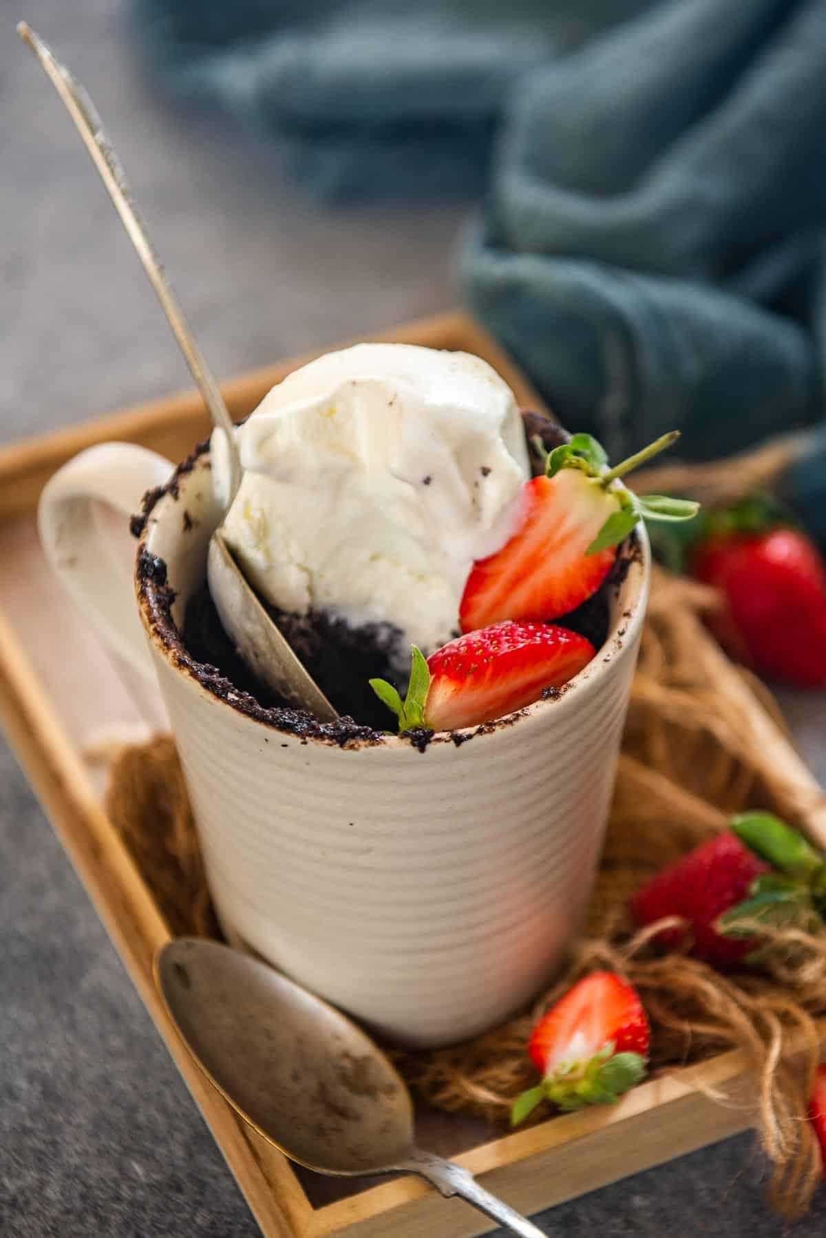 Microwave lava cake served with vanilla ice cream.