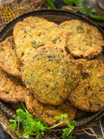 Dhebra is a popular Gujarati deep fried snack or breakfast recipe, that is prepared with bajra flour and methi. It can be served with yogurt, coriander mint chutney, or pickle. Check out the easy recipe to make it.