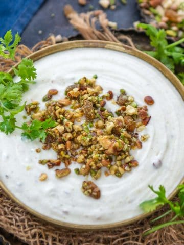 This sweet and salty dry fruit raita is loaded with the goodness of dry fruits and nuts. It will be a good addition to your festive or special meals. Here is how to make it.