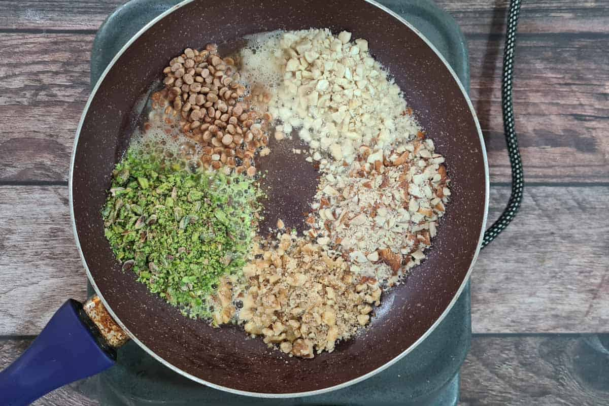 Dry fruits and nuts added to the pan.