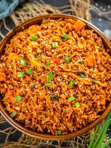 This Korean gochujang fried rice comes together in just 15 minutes and makes for a great main course or side dish. Load it up with veggies, eggs, bacon, or meat of your choice for a spicy treat.