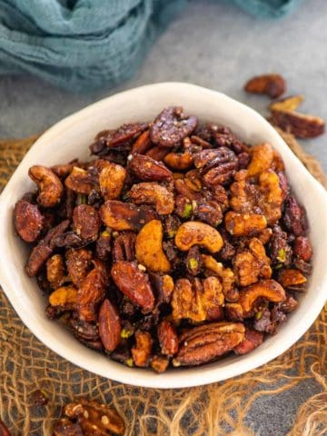 These crunchy, sweet and nutty honey roasted nuts are the perfect healthy snack to much on whenever hunger strikes. These come together in under 30 minutes using simple ingredients.