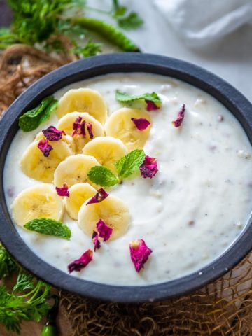 This banana raita or kele ka raita is a refreshing take on the classic Indian raita where ripe mashed bananas are added to the yogurt along with a few mild spices. Here is how to make it.