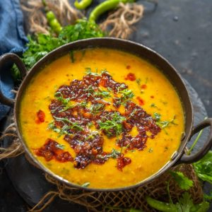 Shahi dal is a rich and creamy Indian lentil dish made using yellow pigeon peas tempered with a sizzling tempering. Serve it with naan or jeera rice for a special meal.