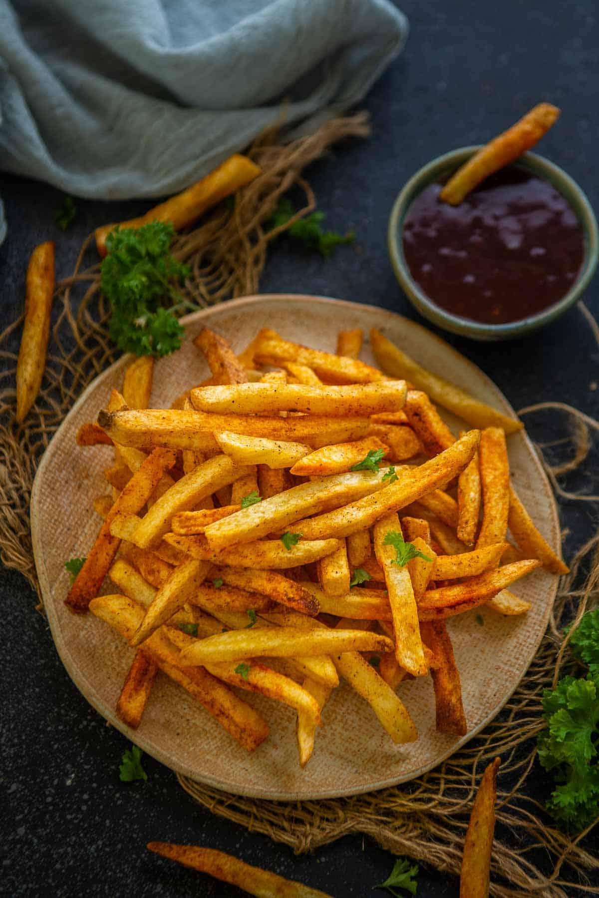 Air fryer frozen french fries served on a plate.