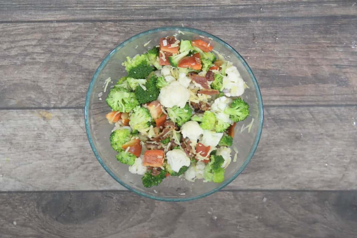 All the salad ingredients added to a bowl.