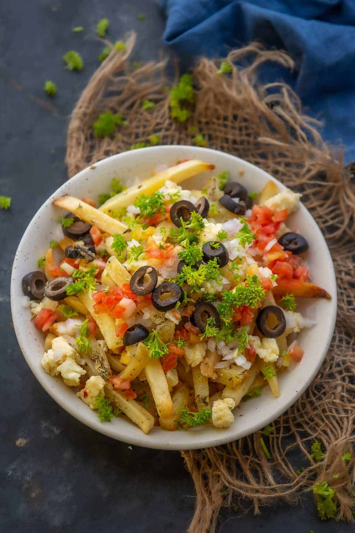 Greek fries served on a plate.