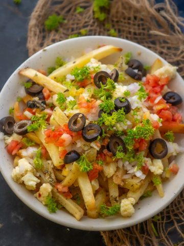 Make these extra crispy Greek Fries in just 15 minutes. Serve them as an appetizer or a side dish for a unique homemade treat (gluten-free).