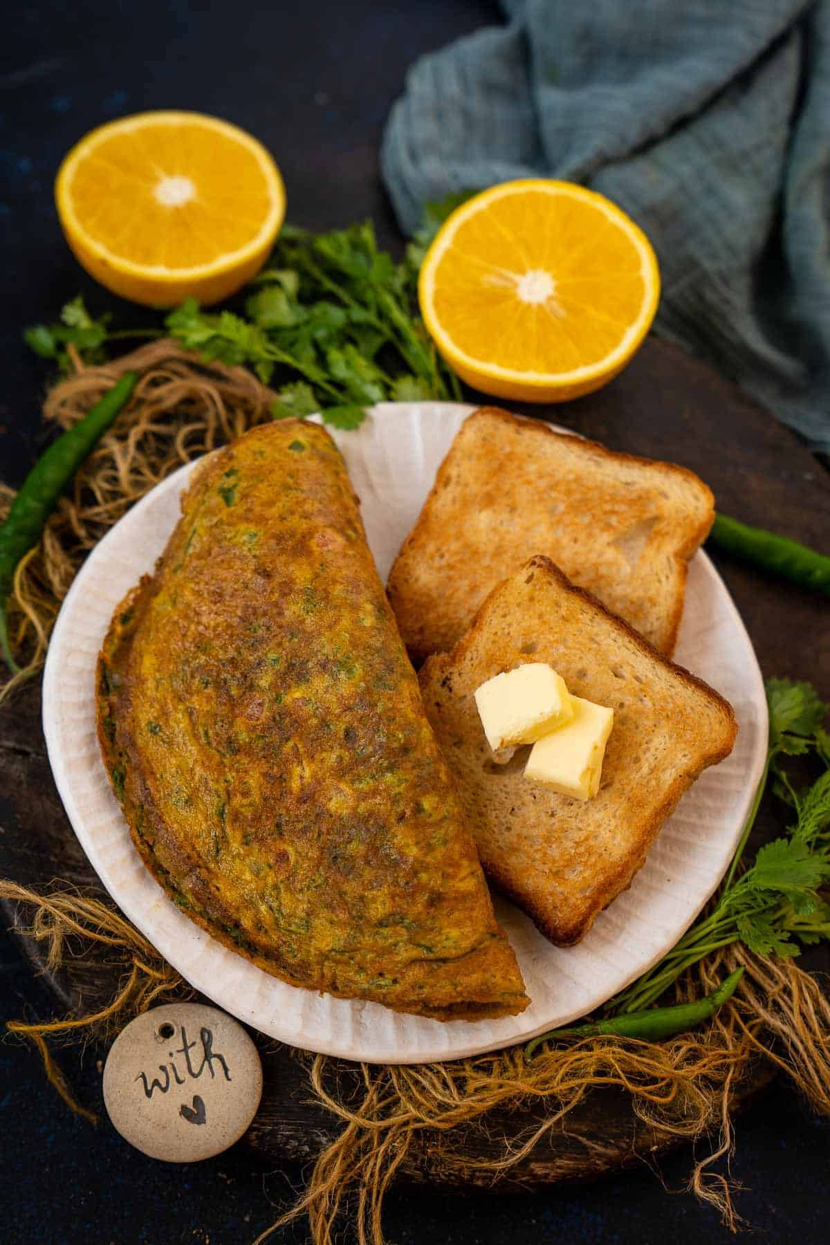 Indian omelette served on a plate.