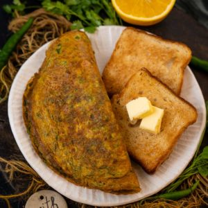 This Indian Omelette is loaded with veggies and spices and is a perfect breakfast that comes together in under 10 minutes. Serve it with bread, toast, chapati, or paratha for a healthy treat.