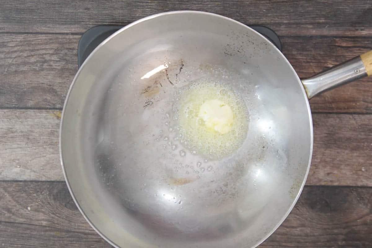 Butter heating in a wok