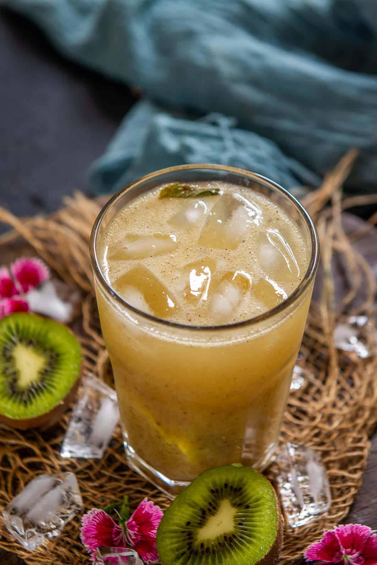 Kiwi soda served in a glass.