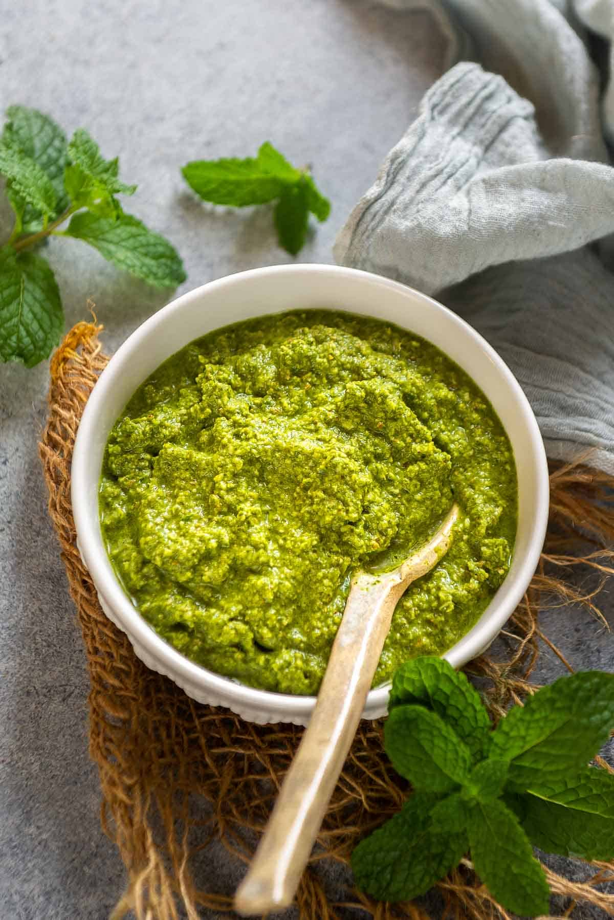 Mint chutney served in a bowl.