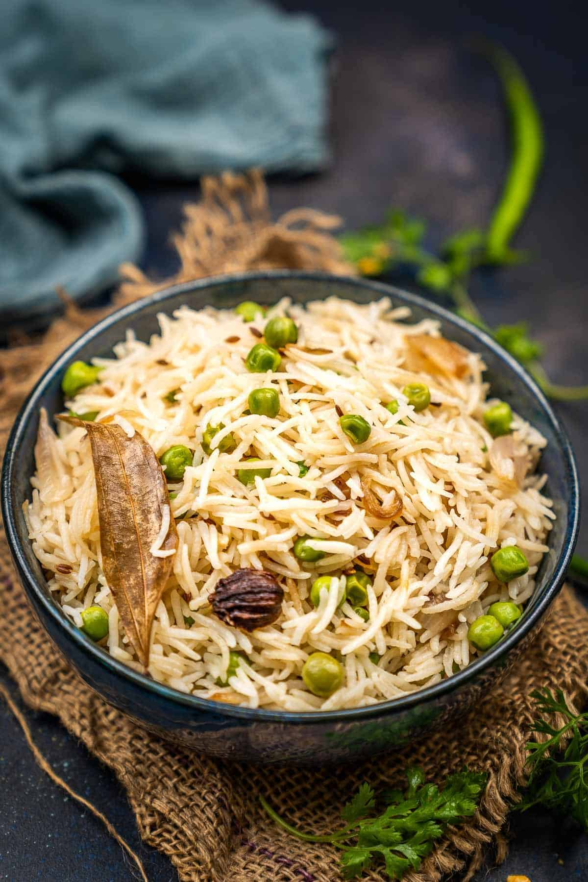 Peas pulao served in a bowl.