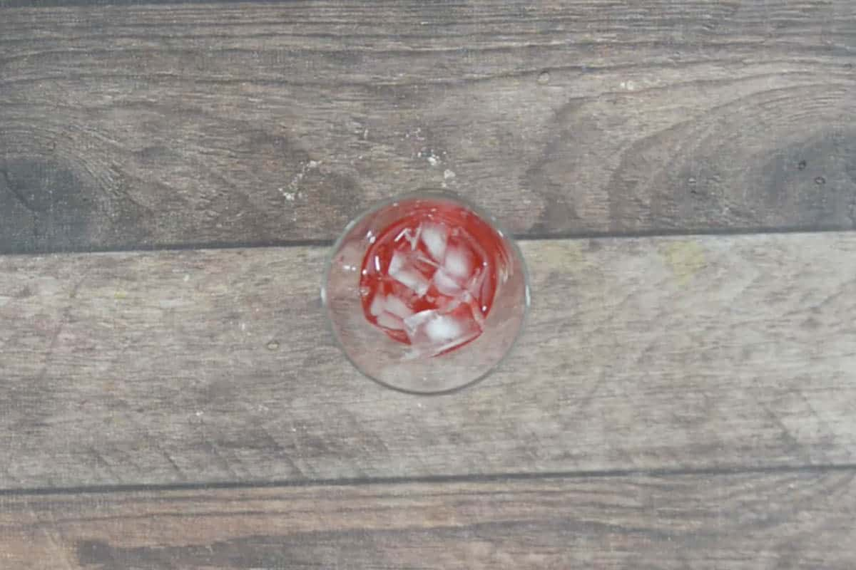 Rose mixture poured in a glass.
