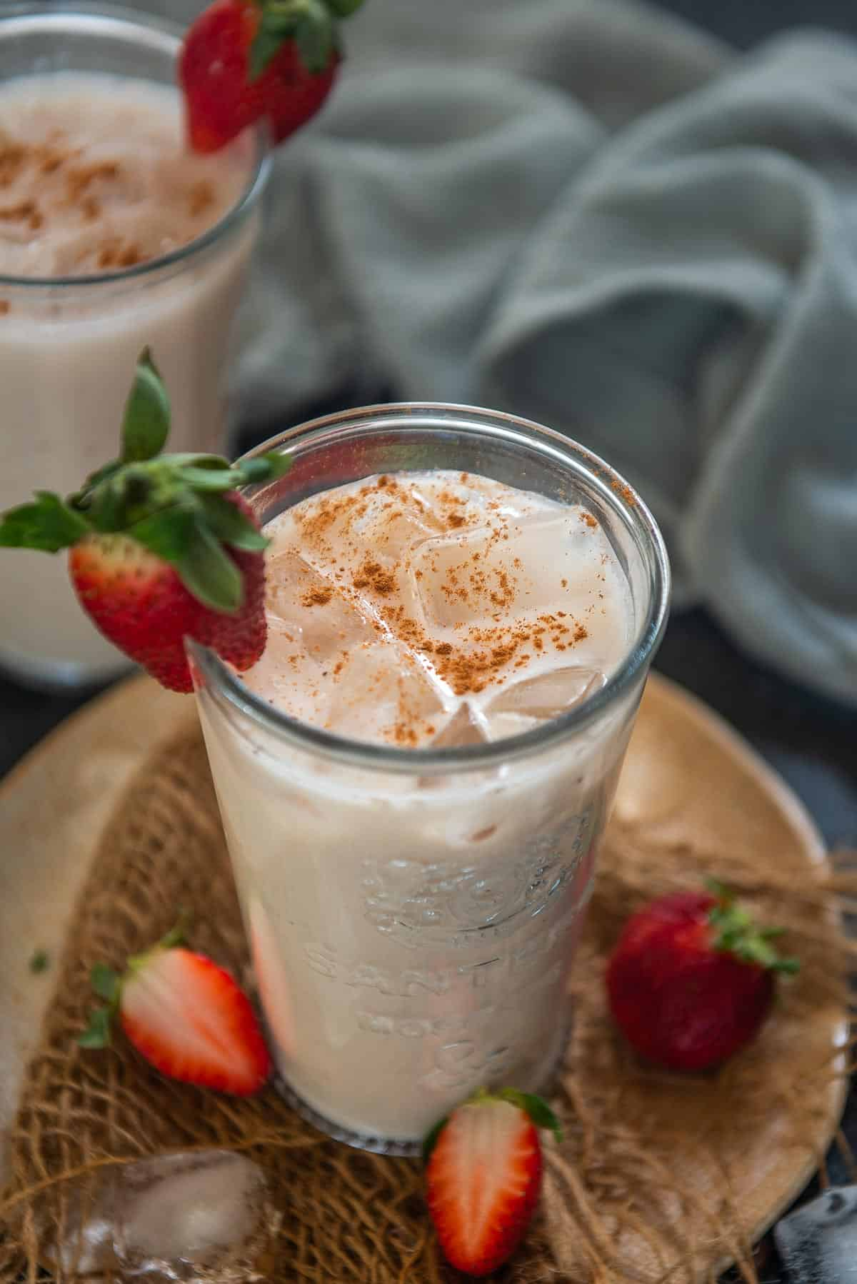 Strawberry horchata served in a glass.