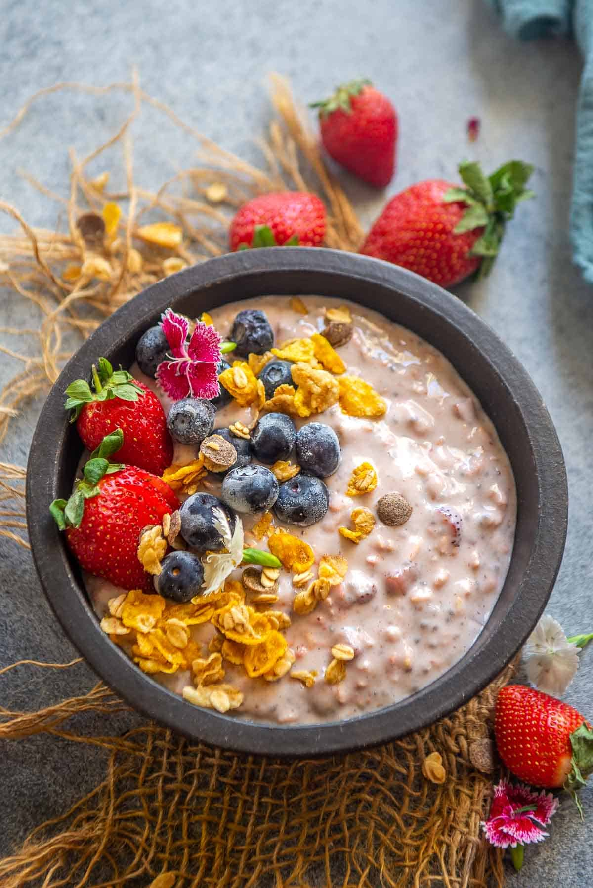 Strawberry overnight oats served in a bowl.