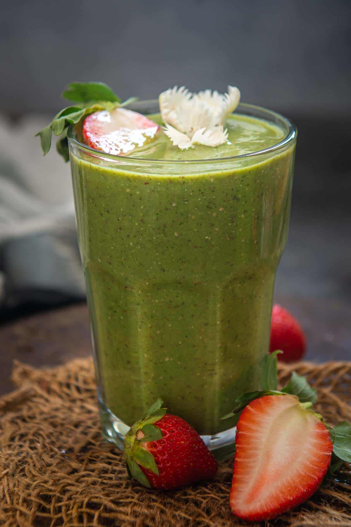 Strawberry Spinach Smoothie served in a glass.