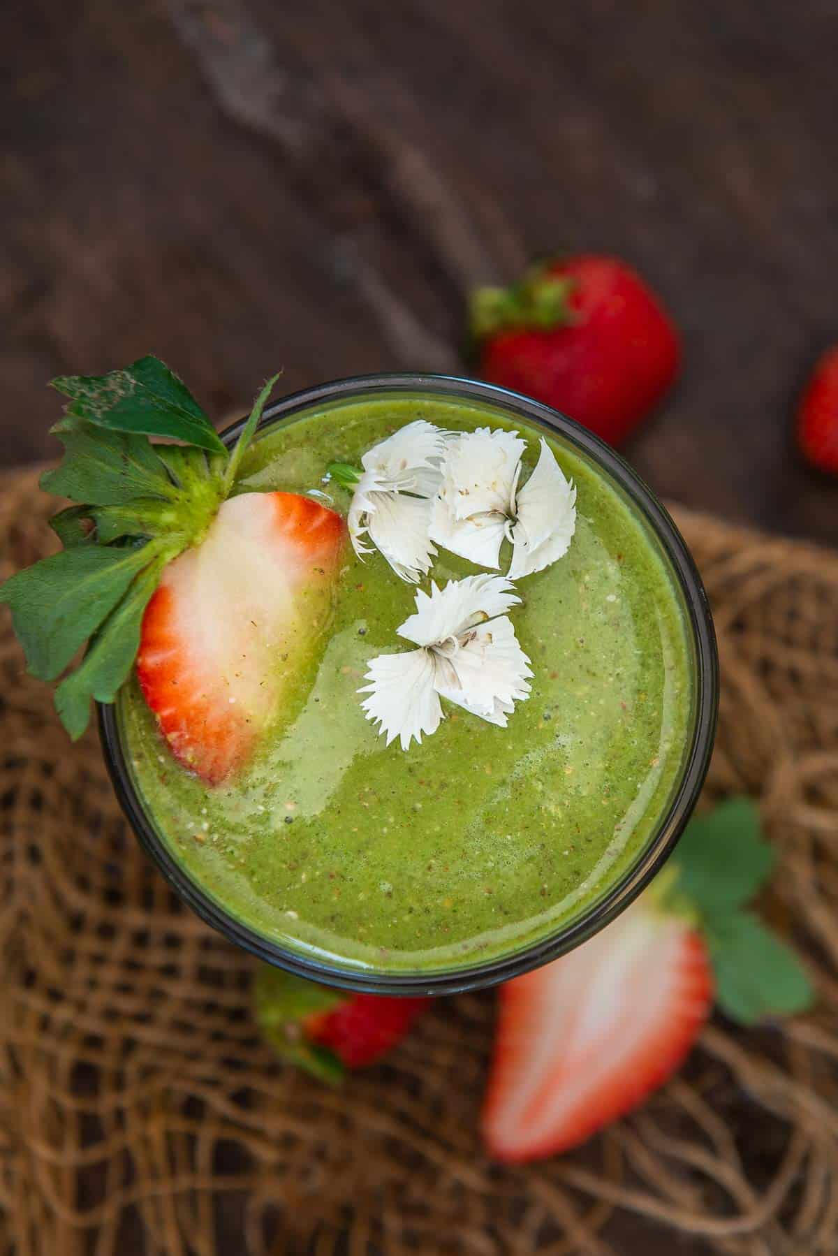 Top shot of strawberry banana spinach smoothie.