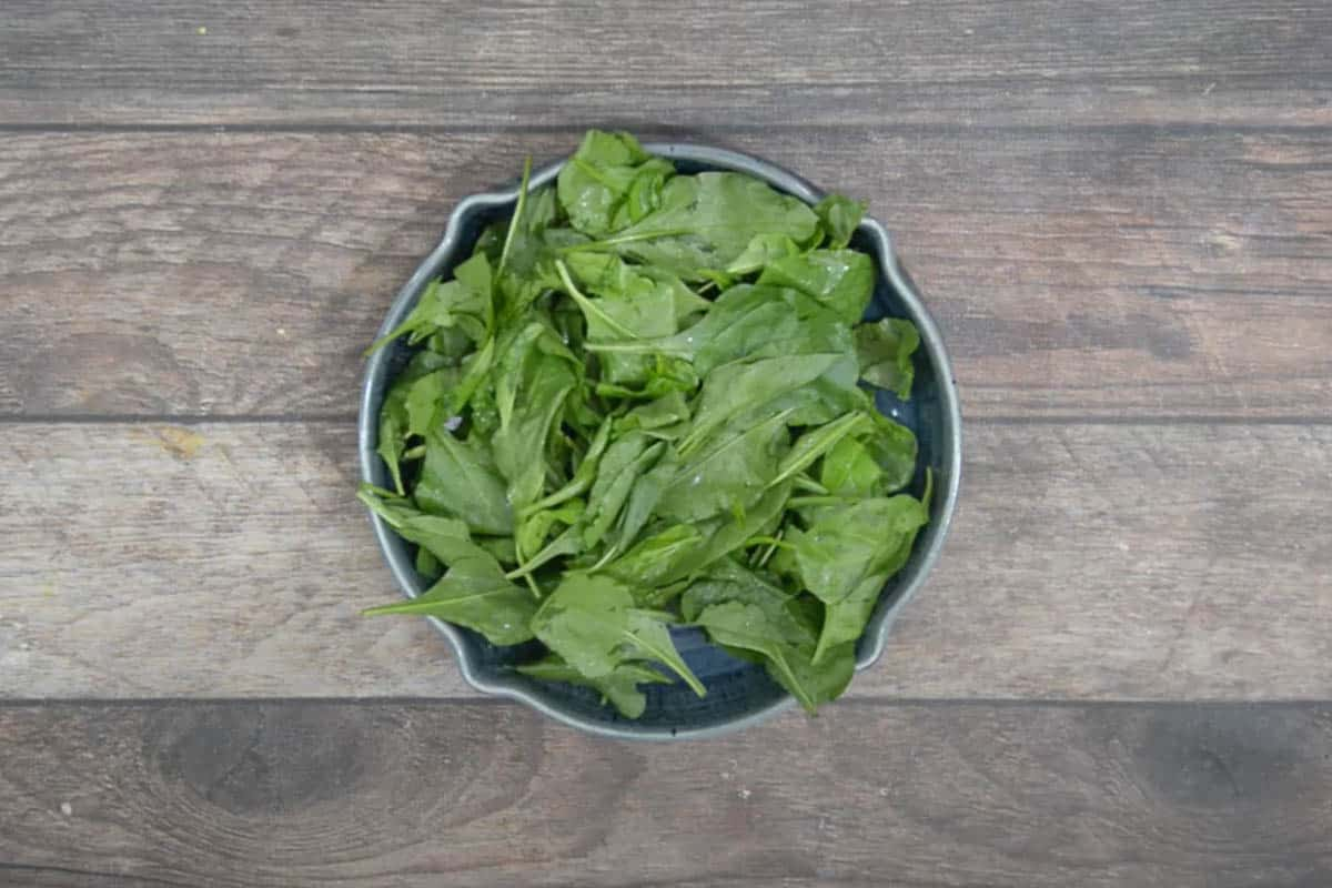 Baby spinach kept on a large serving bowl.