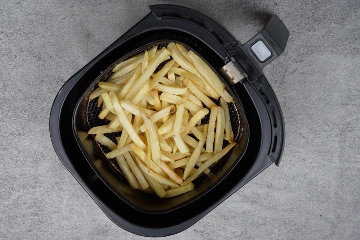 Fries sprinkled with salt .